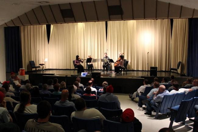 About 125 inmates listened to the Symphony's chamber concert.