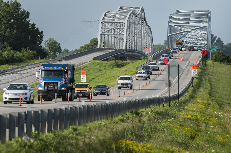 The Liberty Bend Bridge, a pair of continuous truss bridges,  carries cars and trucks from Missouri Route 291 over the Missouri River south of Liberty.