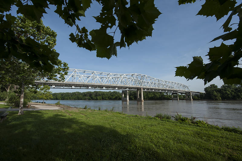 Cottonwood trees frame the Liberty Bend Bridge from the bank below. The Lewis and Clark Expedition camped near what is now La Benite Park on June 25, 1804.