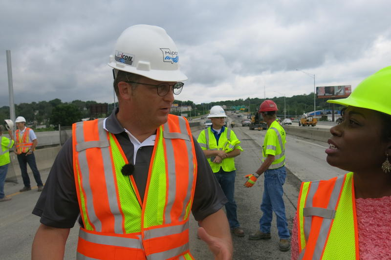 MoDOT Assistant District Engineer Brian Kidwell, left, walks along the old Manchester Bridge, which closed this weekend after 60 years of use. Approximately 100,000 cars a day cross the bridge.