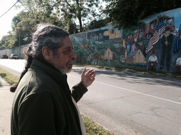 Artist Jose Faus looks at the mural he and his friends painted almost two decades ago on a block of Metropolitan Avenue in the Argentine neighborhood to Kansas City, Kansas.