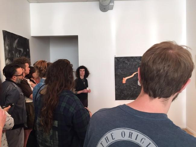Danni Parelman (facing the camera) was one of three artists having work critiqued at Plug Projects in April.
