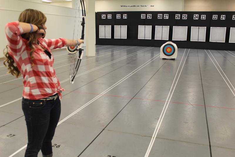 Shelby Winslow raises her bow to take a shot at the Great Olympian Indoor Archery Range in Lee's Summit.