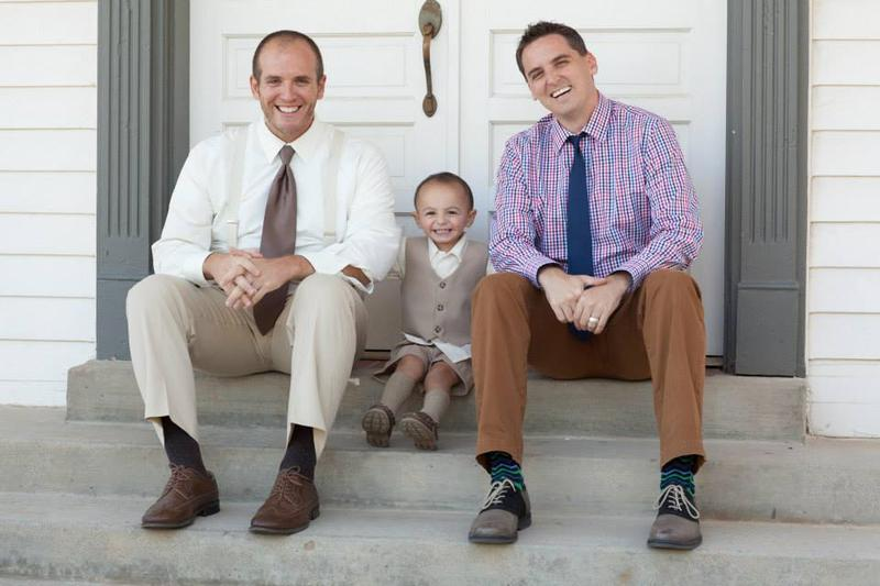 Dustin Cates and Raymond Cattaneo with their son Emmaus.