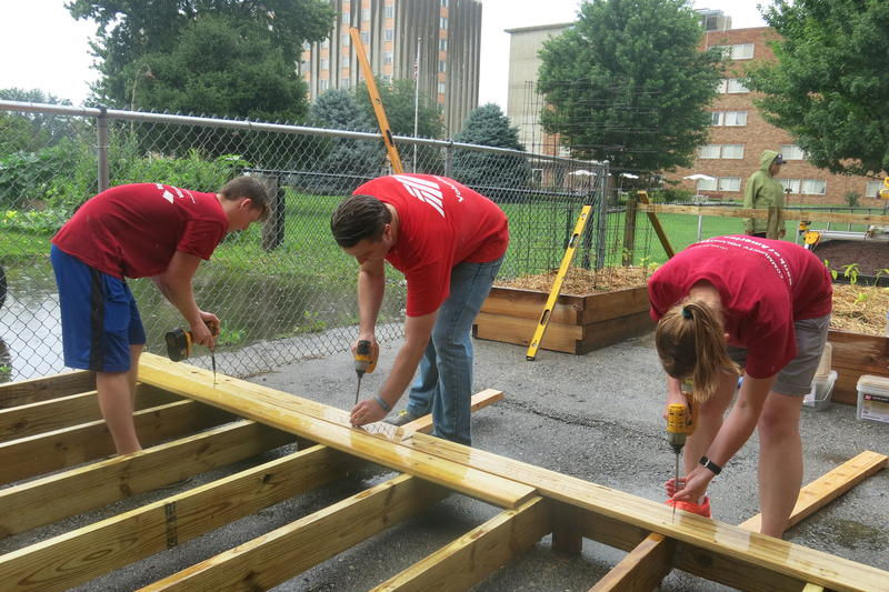 La Raza volunteers build a new deck for an outdoor classroom at El Centro, a dual-language preschool in Kansas City, Kansas.