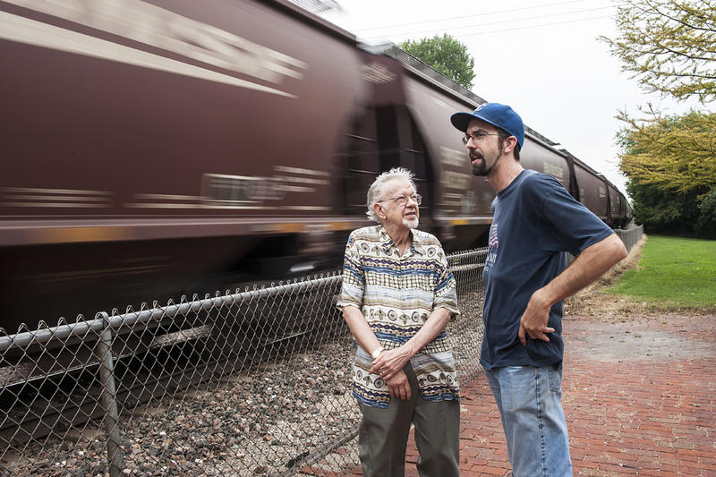 Following the gallery visit, Alex and his father step outside to the roar of a train passing by the old depot.