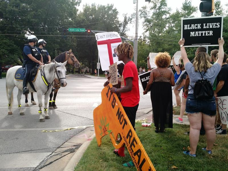 Black Lives Matter protesters with One Struggle KC faced off with mounted police after the group taped off the intersection of 85th Terrace and State Line Road Sunday afternoon.