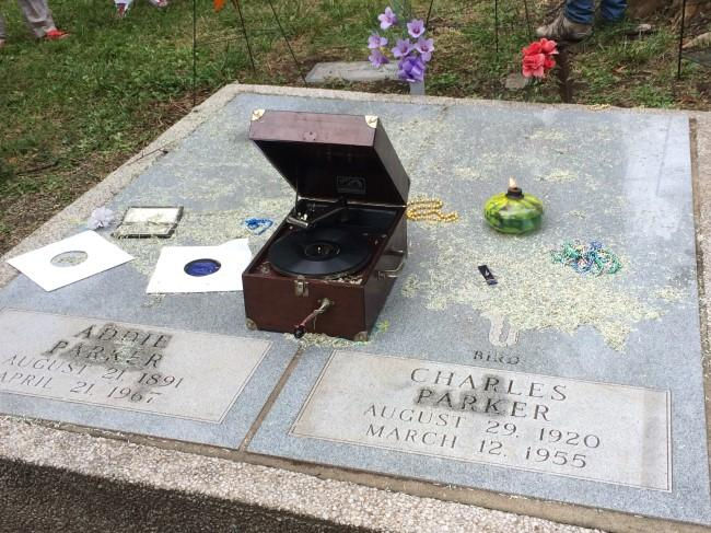 Decorations on Charlie Parker's grave stone at Lincoln Cemetery