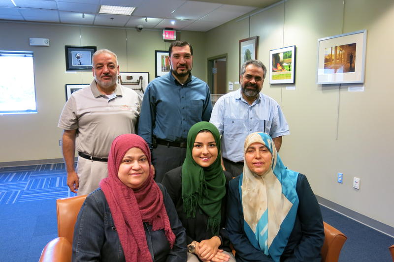 Syrian-Americans Mohamad Albadawi, Mohammad Taha, Jihad Qaddour, Najat Zrieh, Duaa Albadawi and Rouyda Ahmad meet at the Tomahawk Ridge Community Center in Overland Park, Kansas.