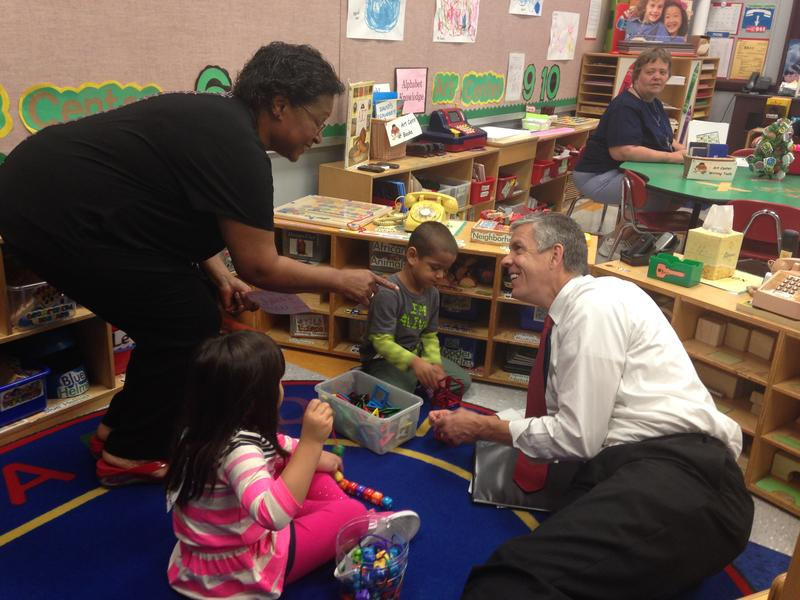 U.S. Secretary of Education Arne Duncan talks to preschoolers in 3-, 4- and 5-year-old classroom at Kansas City's Woodland Early Learning Community.