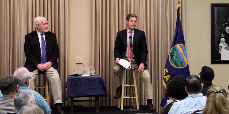 Gov. Sam Brownback and Kansas Sen. Steve Fitzgerald during the meeting Thursday night in Leavenworth.