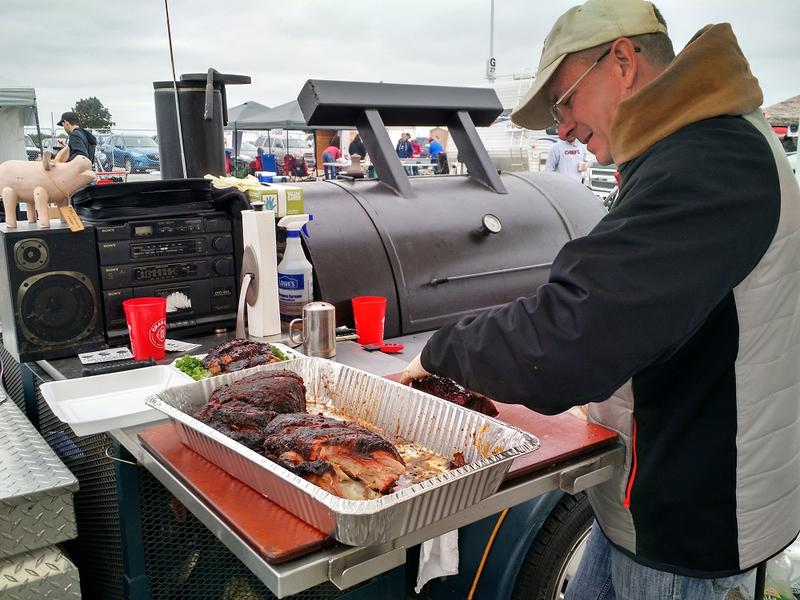 Russell Muehlberger preps some pork for judging at the 2015 World Series of Barbecue, held for the first time outside Arrowhead Stadium.