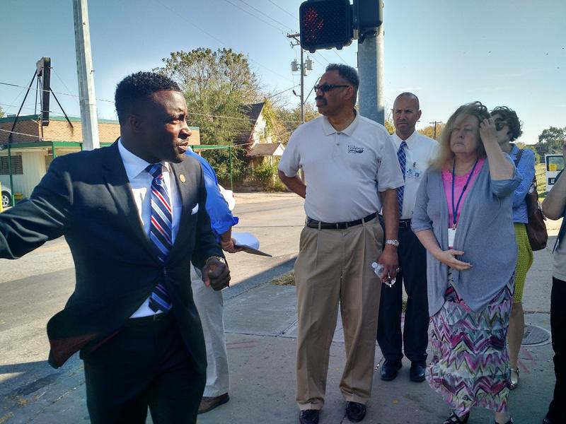 City councilman Jermaine Reed talks to community members and stakeholders on the corner of 27th and Prospect. Reed led the group down Prospect to get feedback on the proposed MAX bus line.