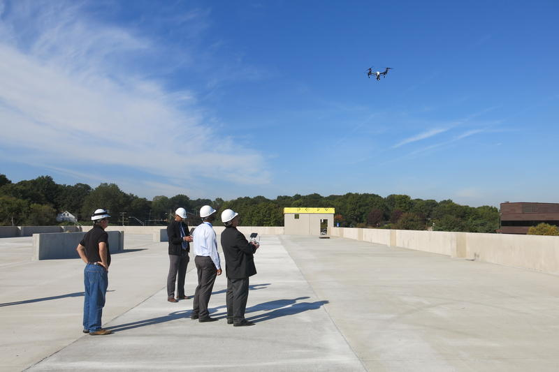A drone flies over the Burns & McDonnell construction site in south Kansas City. The engineering firm is one of the first to receive commercial drone certification from the FAA.