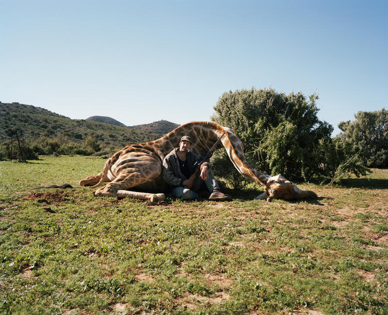 'Hunter with giraffe,' Ladysmith, South Africa.
