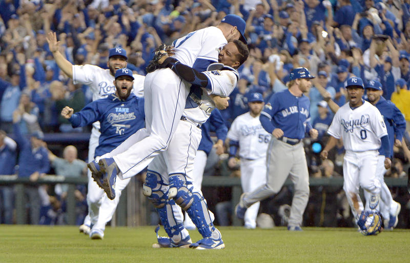 Kansas City Royals relief pitcher Wade Davis (left) celebrates with catcher Salvador Perez (right) after defeating the Toronto Blue Jays in game six of the ALCS at Kauffman Stadium on Oct. 23, 2015.