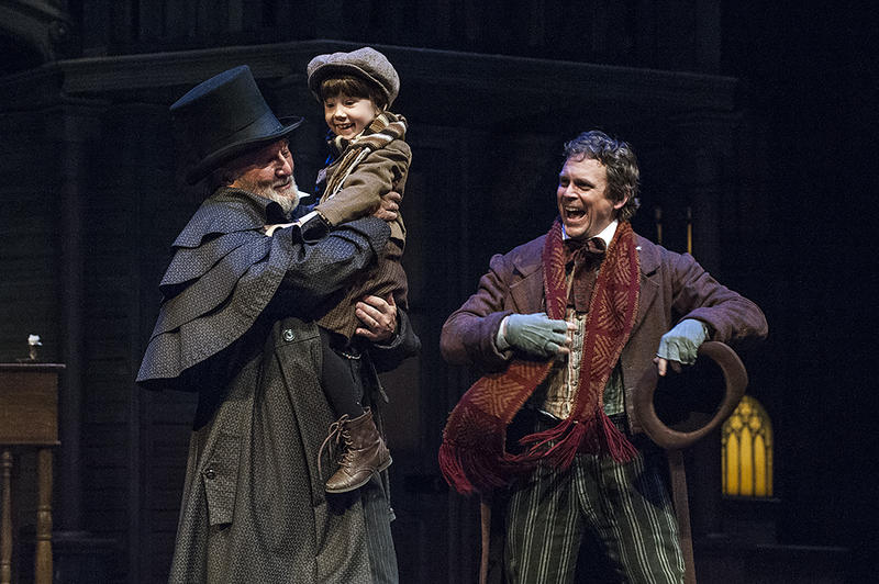 From left: Performers Gary Neal Johnson as Ebenezer Scrooge, Delilah Rose Pellow as Tiny Tim, and Jason Chanos as Bob Crachit took the stage during a Thursday-night dress rehearsal of 'A Christmas Carol.'