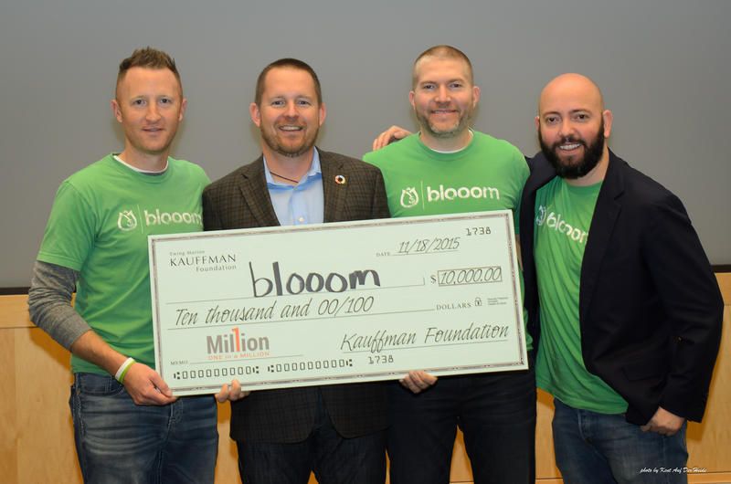 Blooom co-founders Kevin Conard, Chris Costello and Randy AufDerHeide, along with President Greg Smith pose with the grand prize check at the 'One in a Million' startup competition.