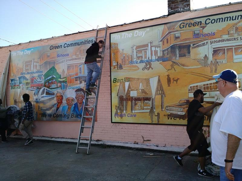 Youth artists from ArtsTech unveil a new mural at 39th and Prospect in Kansas City, Mo. The art was commissioned by the No Violence Alliance as part of their initiative to curb violent crime along Prospect.