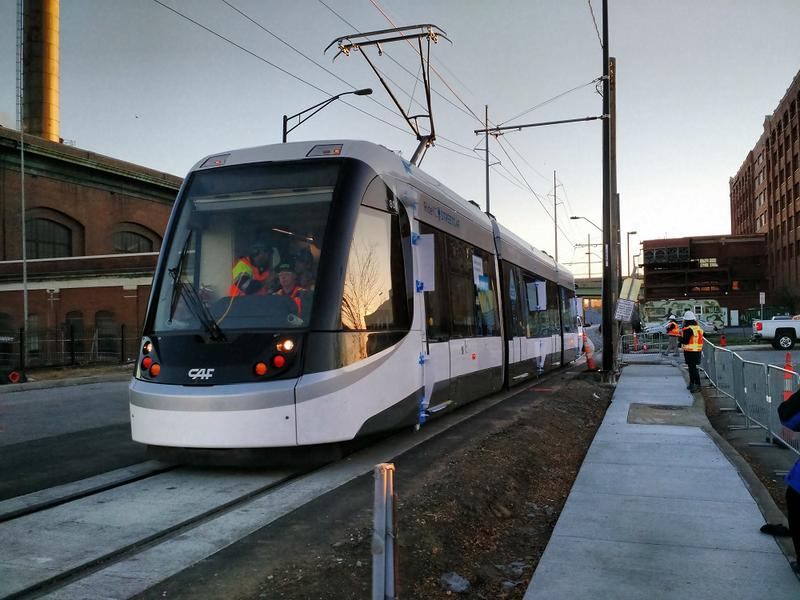 Kansas City's downtown streetcar made its first powered run along its 2.3 mile route early Thursday. Workers tested visibility for streetcar operators and made sure power cables maintained good contact.