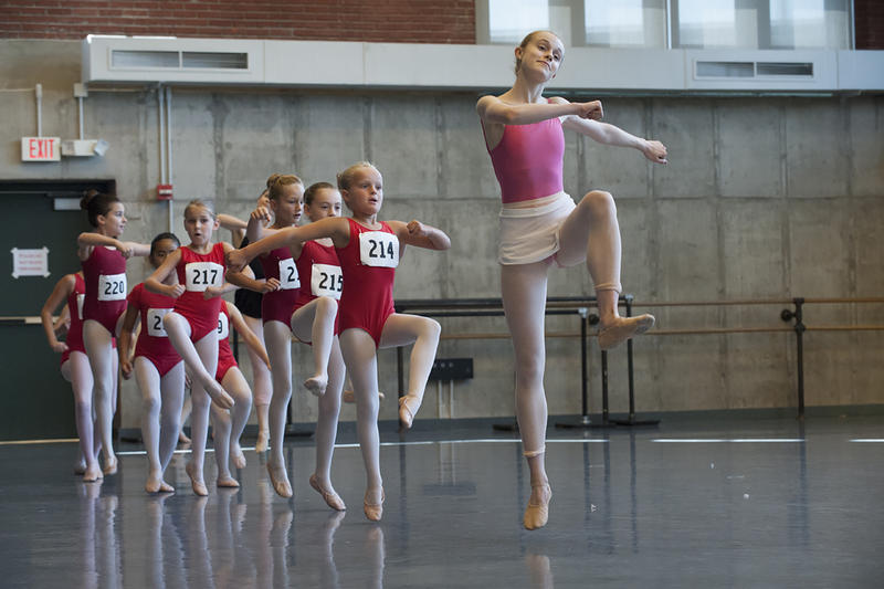 Kansas City Ballet trainee Zoe Stein leads young dancers across the rehearsal floor in August.