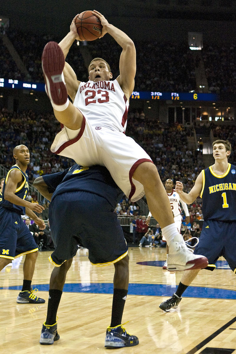 Oklahoma forward Blake Griffin flips over the back of Michigan guard Manny Harris during a March 21, 2009, NCAA second round basketball game between Michigan and Oklahoma at the Sprint Center in Kansas City, Missouri.