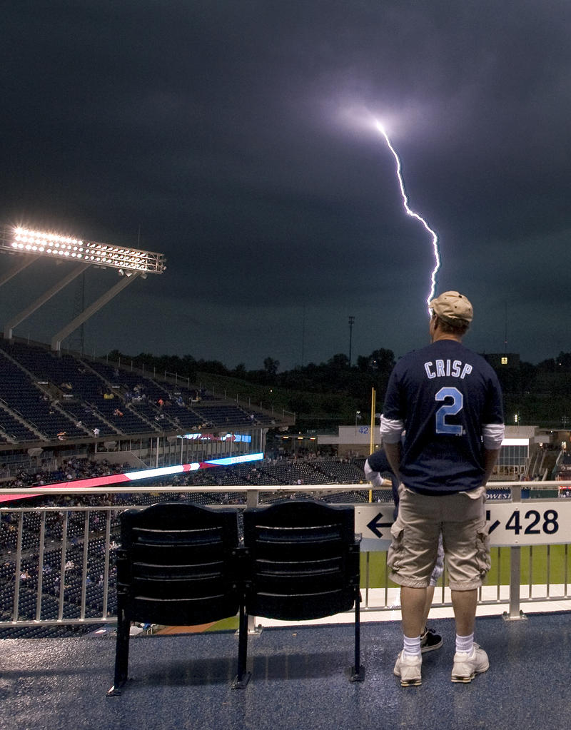 Shawn Green, of Kansas City, Missouri, waited out the rain delay in the upper deck as lightening struck outside the stadium before a May 15, 2009, baseball game between the Kansas City Royals and Baltimore Orioles at Kauffman Stadium.