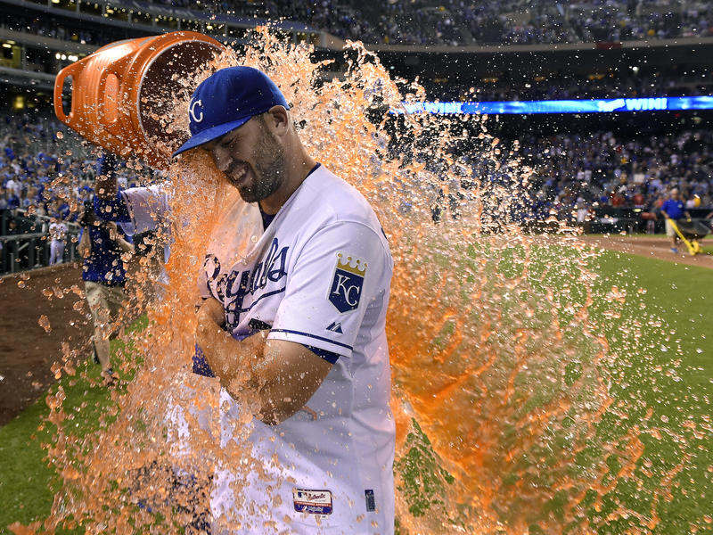 The Kansas City Royals' Mike Moustakas gets the celebration Gatorade dunking from Salvador Perez after the team's 7-4 win over the Boston Red Sox during a baseball game on June 20, 2015, at Kauffman Stadium in Kansas City, Missouri.