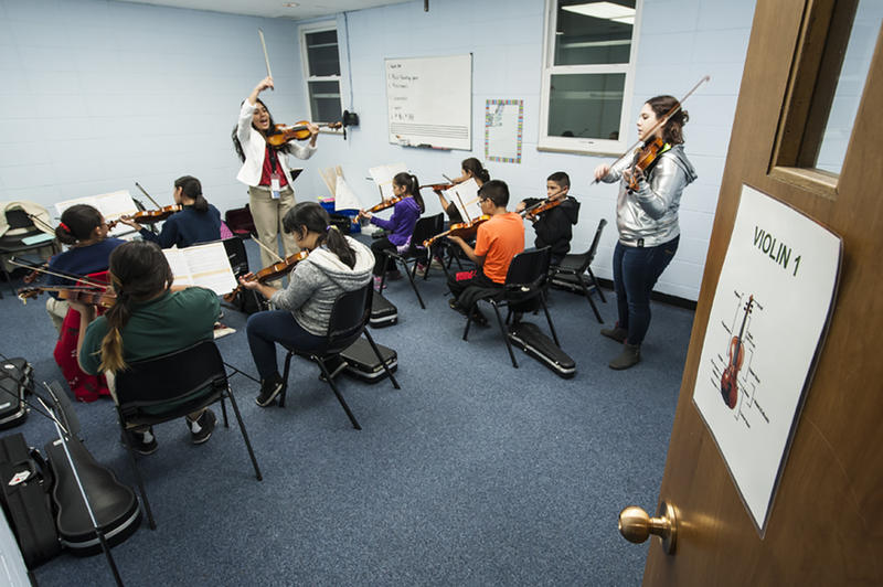 Hernandez instructs students in the Violin 1 Class in a small classroom at the Northeast Community Center.
