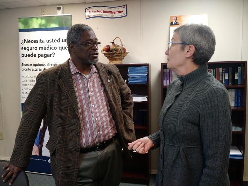 Mayor Sly James talks with Dawn Lindsey, who says she would be stuck with $500,000 in medical bills without health insurance from the Affordable Care Act.