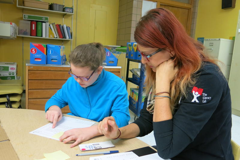Missouri Reading Corps tutor Caren Collins, right, works with third grader Laila Kaster at Garfield Elementary in the Historic Northeast.