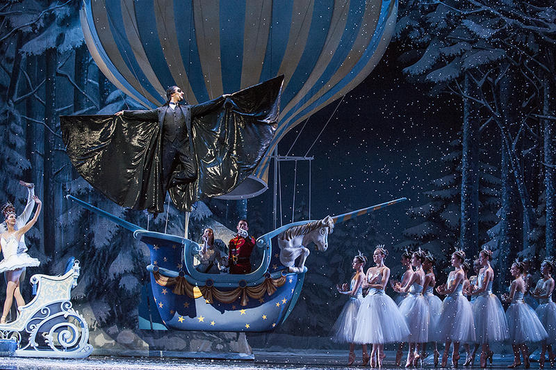Drosselmeier  (Ryan Jolicoeur-Nye) takes flight into the 'Land of the Sweets' with Clara (Sarah Waller) and her Prince (Charles Martin).