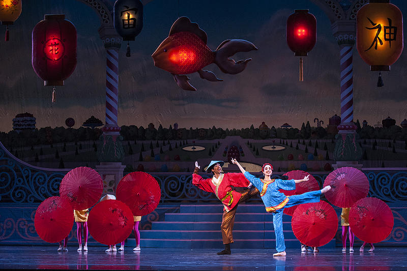 Michael Davis and Amanda DeVenuta dance beneath glowing Chinese lanterns.
