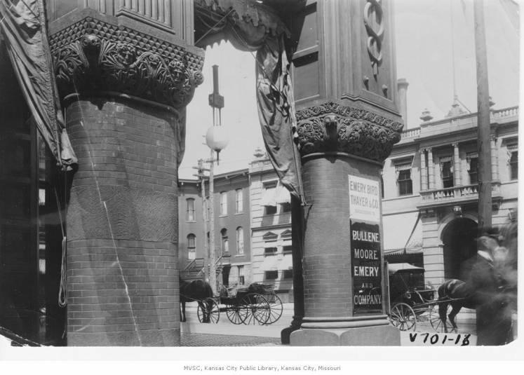 A close up view of the columns on the exterior of the Emery, Bird, Thayer building, designed by the firm Van Brunt & Howe.