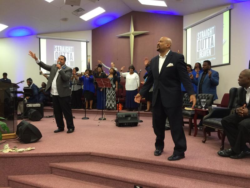 At a Sunday morning church service at New Bethel Church in Kansas City, Kansas, Pastor A. Glenn Brady (right) turns the mic over to singer John M. Tobert.
