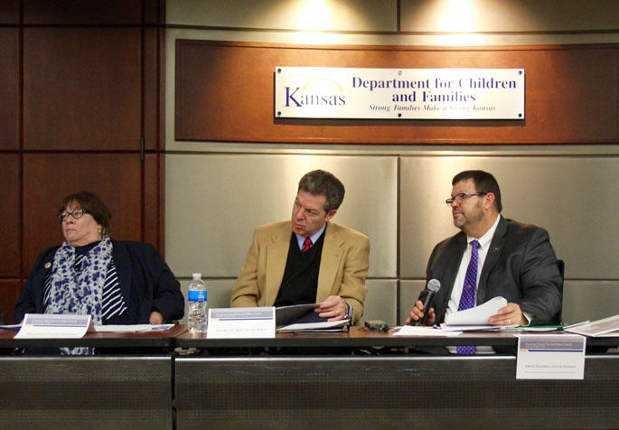 Members of the governor's Social Services Policy Council met Wednesday. From left, Phyllis Gilmore, secretary of the Department for Children and Families; Gov. Sam Brownback; and Johnnie Goddard, interim secretary of the Kansas Department of Corrections.