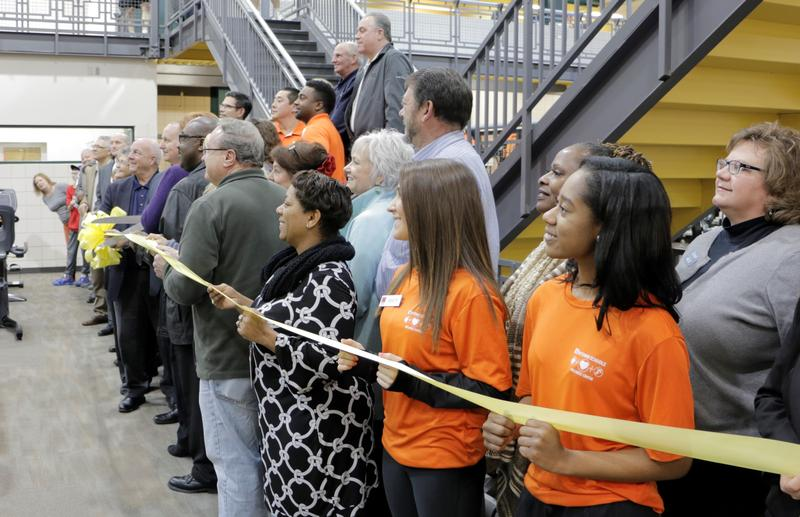 Staff members and a host of other attendees joined Raytown school officials last week as they cut the ribbon on a new community center.