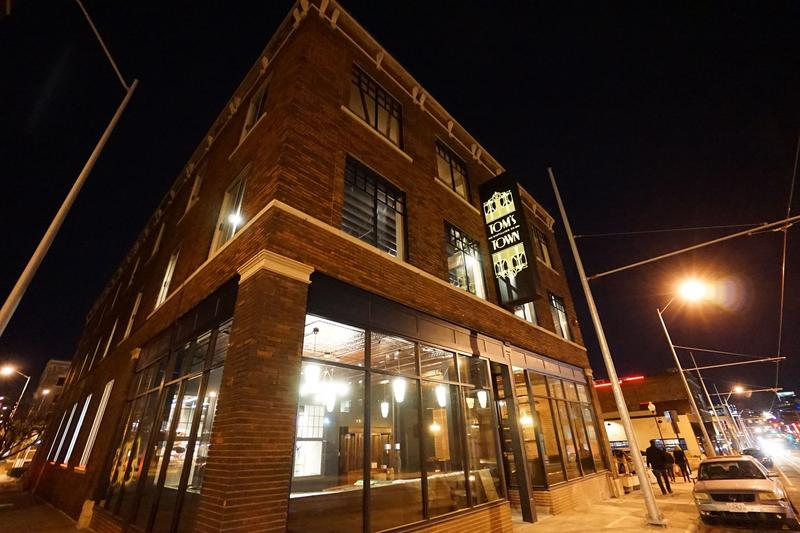 Tom's Town is a distillery that offers tours and has a speakeasy with a drink menu and small plates.