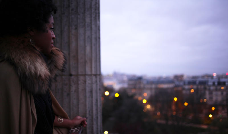 "Julia Haile, singer for The Buhs, looks out over the scenery in Paris, France during the filming of the group's music video for their first single ""Can't Let Go,"" set for release on Feb. 14."