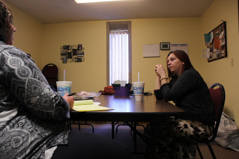 At a domestic violence shelter in Hays, Kansas, Leyila, right, tells shelter director Tiffany Kershner she needs to see an ob-gyn but can't afford it.