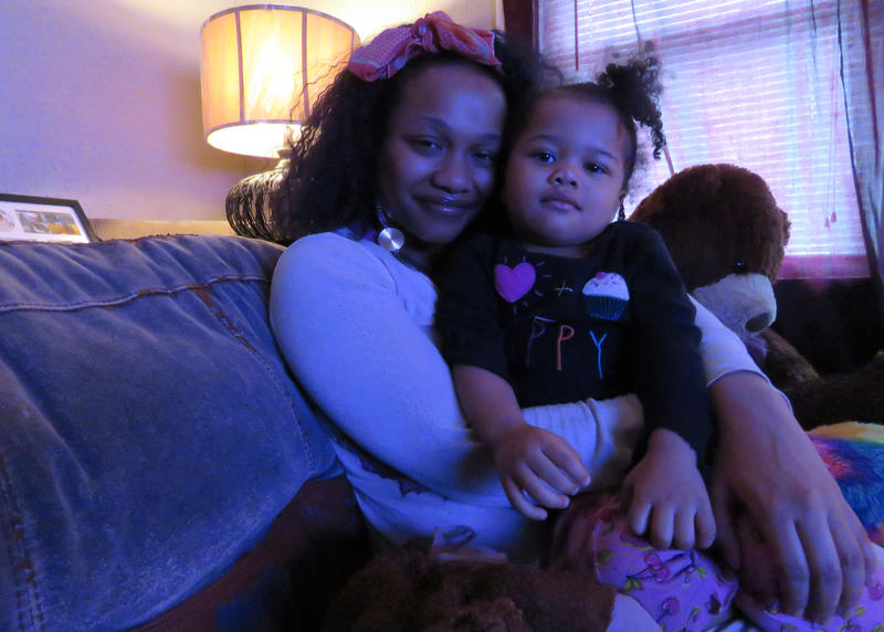 Lajua Manning, a single mom, struggles to afford child care for her 2-year-old daughter, Rayaira. She rearranged her schedule to take early evening classes and work the overnight shift in order to be able to spend the daytime caring for her daughter.