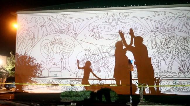 A projection of the mural in progress in Arkadelphia, Arkansas, in 'Called to Walls.'