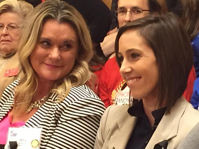 Cancer survivors Amy Holdman, left, and Marcie Kelly were among the supporters of a bill prohibiting the use of tanning beds by minors who packed a Tuesday hearing at the Kansas Statehouse.