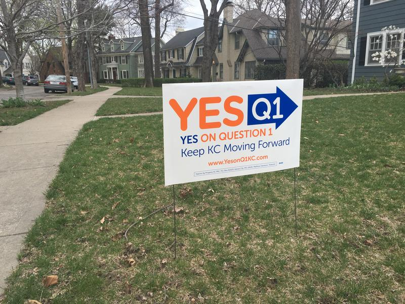 A yard sign in Kansas City's Brookside neighborhood urges a yes vote on question one, the city's 1 percent earnings tax.