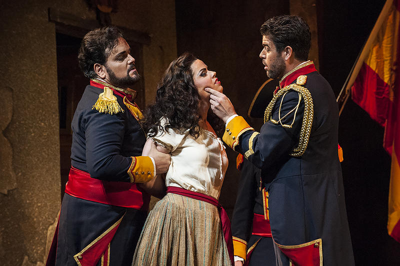 Don Jose (tenor Rafael Davila) and Zuniga (bass Jeffery Beruan) arrest Carmen (Svede) for fighting with another girl.