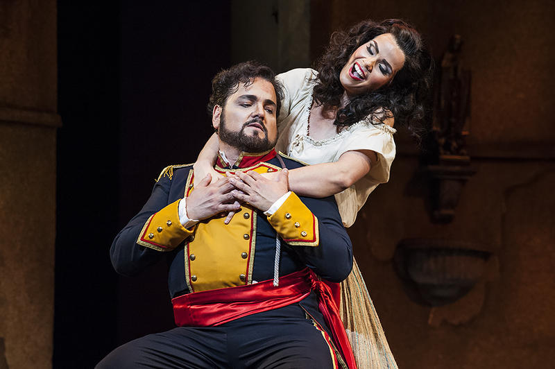 Jose (Davila) succumbs to Carmen (Svede), agreeing to let her escape from prison.