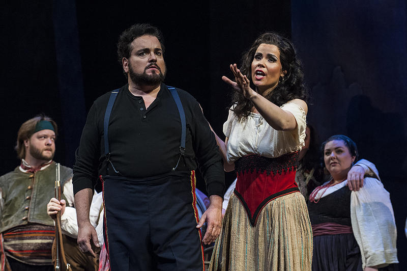 Jose (Davila) is uncertain as  Carmen (Svede) invites him to desert the army and join her in the mountains.