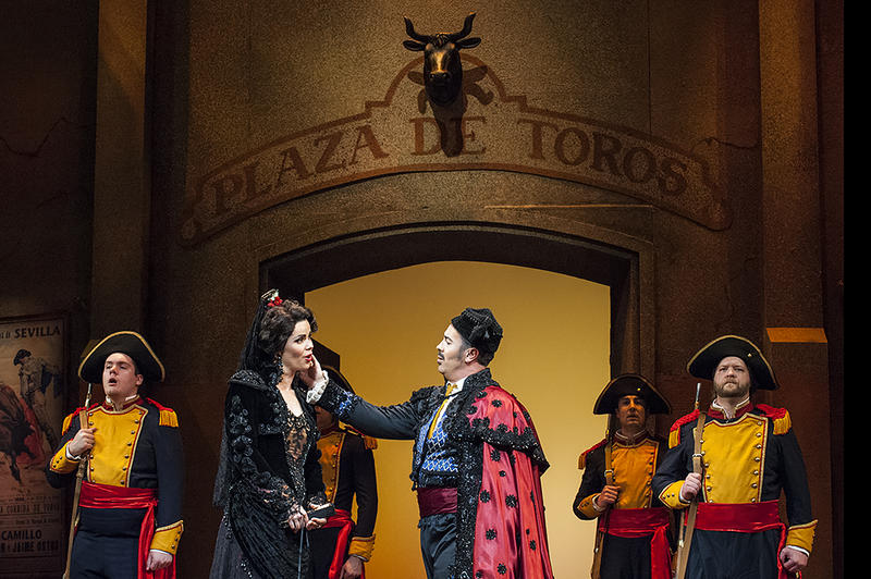 Carmen (Svede)  attends the bullfight with her new lover, the toreador Escamillo (baritone Corey Crider).