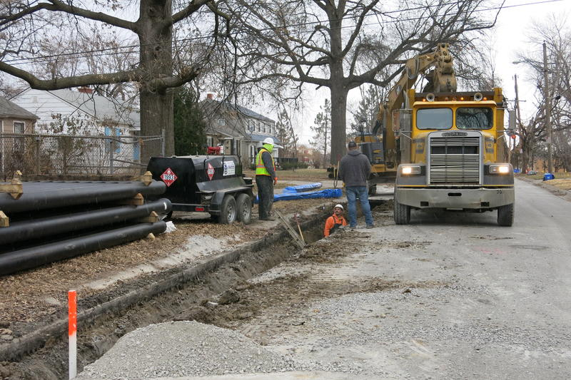 A work crew replaces a water main at 75th and Wyandotte. It will take six months to complete a two-block span.