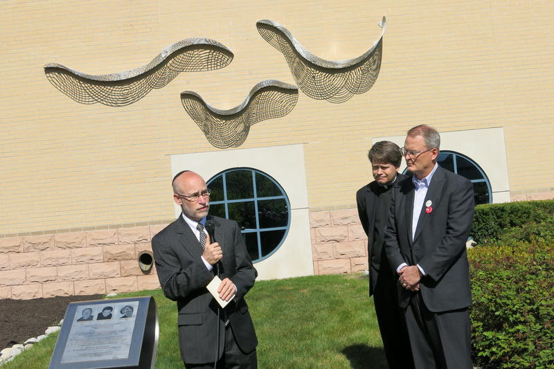 Rabbi Arthur Nemitoff, Father Stephen Cook and Rev. Adam Hamilton offer blessings over the memorial for the victims of the Jewish Community Center and Village Shalom shootings.